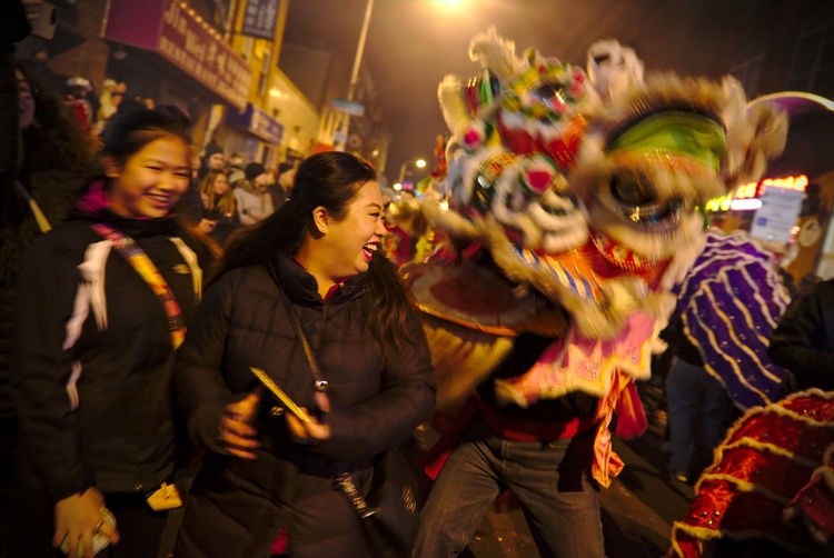 Philadelphians celebrate the Year of the Rooster with Chinese lion dances, fire crackers and more. Celebration China Town Phil Chinatown Chinese New Year Chinese New Year 2016 Chinese New Year 2017 Color Colorful Crowd Dancing Friendship Happiness Lifestyles Light Night Night Photography Nightlife Party - Social Event People People Watching Philadelphia Smiling Two People Women Young Women