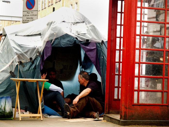 Men sitting in tent