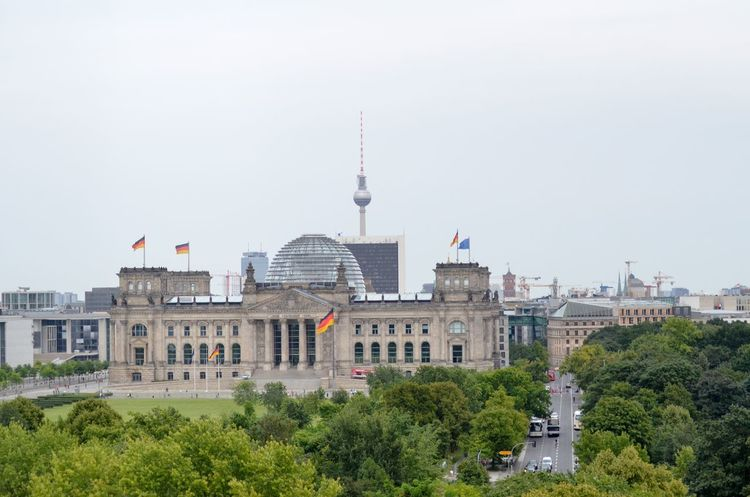 Architecture Building Exterior Built Structure Travel Destinations City Government Day Outdoors Sky Tree Nature Parliament Berlin Cityscape Travel Destination Reichstag Drone Perspective Copy Space Regierungsviertel