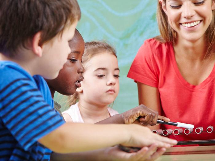 Children and teacher in classroom