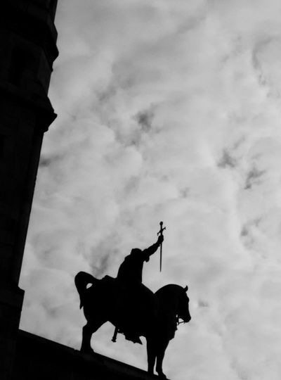 Stop waiting for things to happen. Go out and make them happen. Statue Silhouette Man On Horseback Sword Taking Charge Balck And White Sky - Traveling in Paris, France
