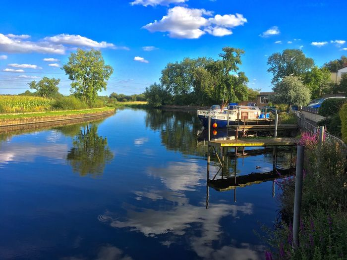 Dinner by the river at the Otter. Reflection Sky Cloud - Sky Water Tree Lake Nature Outdoors Day No People Nautical Vessel Beauty In Nature Moored Blue Scenics