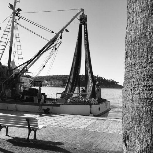 Fishing boat in harbor Adriatic Black And White Boat Calm Croatia Dalmatia Europe Fisherman Fishing Harbor Makarska Marine Mediterranean  Nautical Vessel Net Ocean Outdoors People Port Sea Ship Transportation Travel