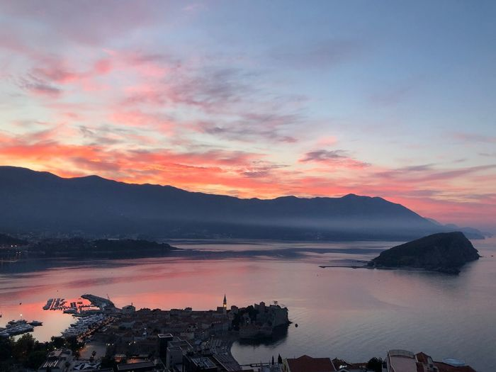 Red sky Montenegro Budva Sky Cloud - Sky Sunset Beauty In Nature Water Scenics - Nature Sea Mountain Idyllic Outdoors No People Nature Tranquility Land Tranquil Scene Orange Color Reflection Travel Destinations Beach Autumn Mood