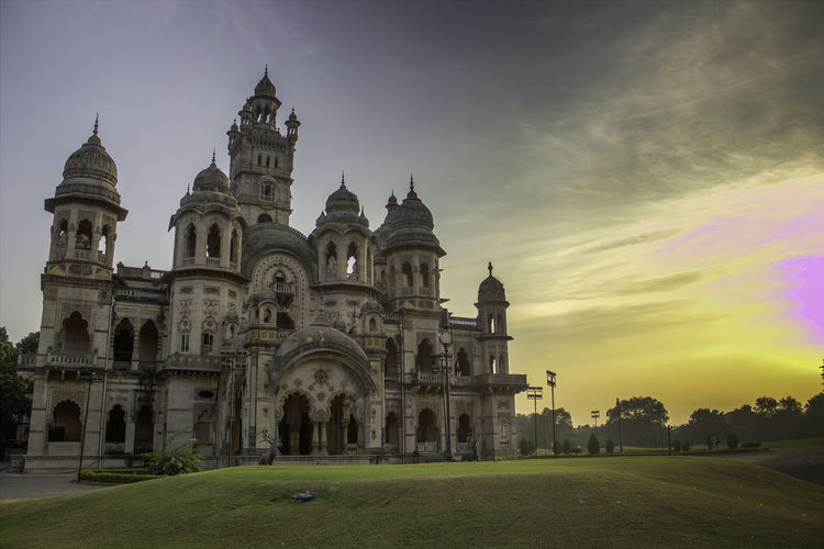 View of laxmi villas palace against a dramatic sunset in vadodara the state of gujarat in india