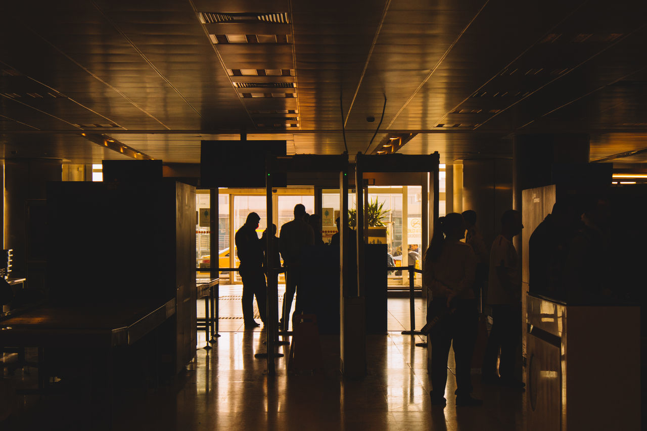 indoors, real people, illuminated, men, walking, medium group of people, full length, lifestyles, silhouette, women, architecture, day, people