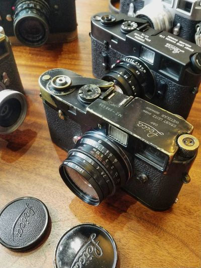 Photography Themes Technology Camera - Photographic Equipment Table Old-fashioned High Angle View Camera Close-up