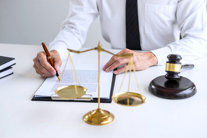 Midsection Of Lawyer Working In Office