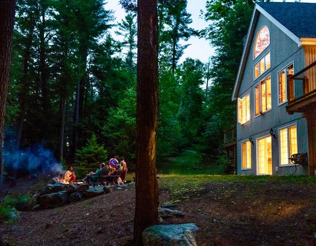 Roasting marshmallows by the campfire Family Time Bonding Unplugged Cottage Life, Cottage Garden  Cottage Night Bonfire Tree Plant Built Structure Growth Nature Architecture The Great Outdoors - 2018 EyeEm Awards Building Exterior Green Color Real People Outdoors Trunk