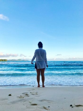 Sea Rear View Beach Real People Horizon Over Water Nature Sky Model Seychelles Maheisland Beauty In Nature Seychellesisland Modeling Water Standing One Person Full Length Scenics Blue Clear Sky Leisure Activity Sand Lifestyles Day Outdoors