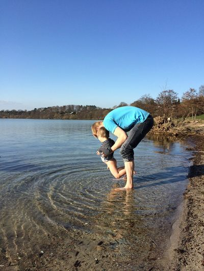My son reluctant to try the cold water of the lake Beauty In Nature Blue Casual Clothing Enjoyment Fun No Pants Ripples In The Water Scenics Shore Water