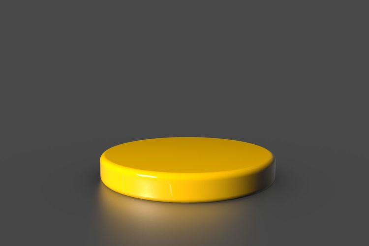 Close-up of yellow lamp over black background