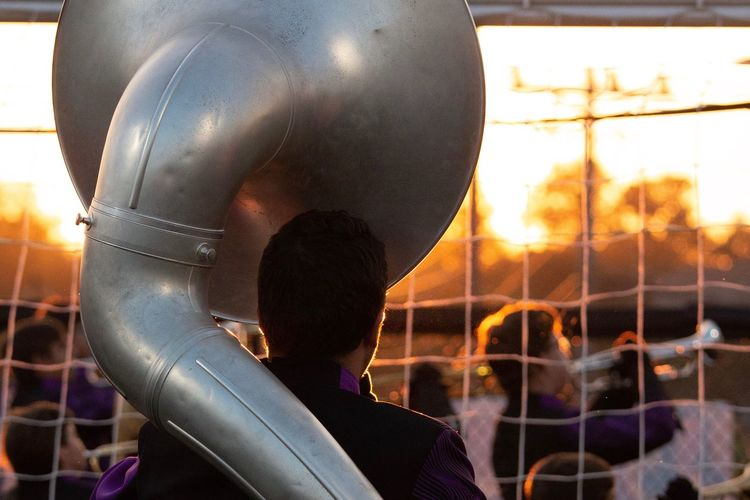 Musical Instrument Bong Football Sky Real People Nature Fence Sunset Close-up Outdoors Men Lifestyles