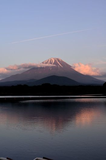 The Great Outdoors - 2017 EyeEm Awards Mountain Beauty In Nature Nature Sky Mountain Range Lake Outdoors Sunset Contrail Mt.Fuji Shouji.lake Scenics Tranquility Tranquil Scene No People Water Landscape Power In Nature Day