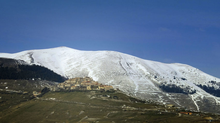 Altopiano Beauty In Nature Blue Castelluccio Clear Sky Clear Sky Cold Temperature Famous Place Hill Historic Town Idyllic Italy Landscape Mountain Range Norcia Plateau Small Town Snow Snowcapped Snowcapped Mountain Tranquility