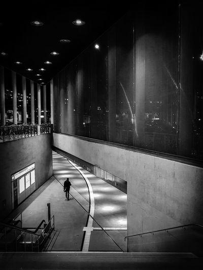 Man walking in illuminated building at night