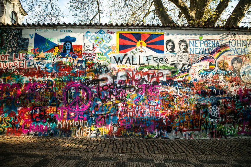 EyeEm Gallery Lennon Wall Praha The Week on EyeEm Tourist Travel Architecture Art And Craft Building Exterior Canonphotography City Creativity Day Graffiti Light And Shadow Multi Colored No People Outdoors Street Art Travel Destinations