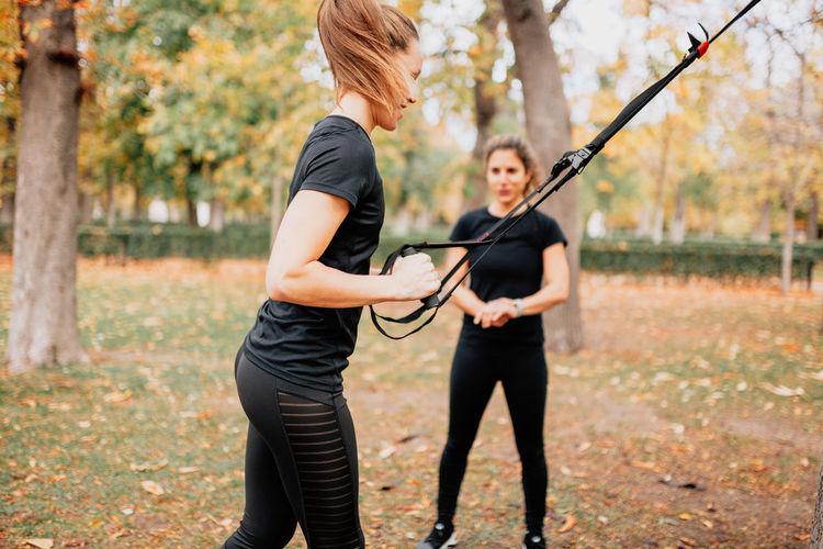 Smiling women exercising at park