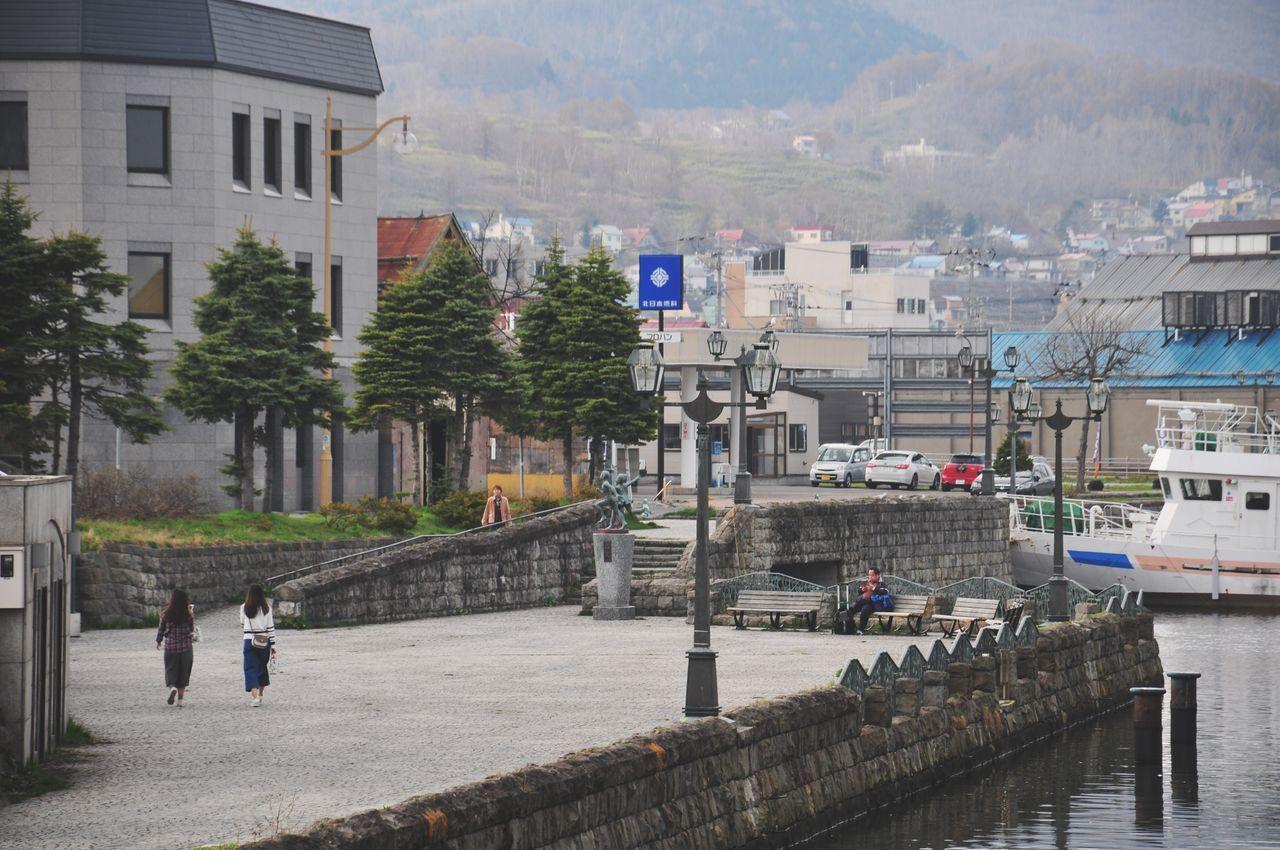 Rear View Of Women Walking On Pier By River