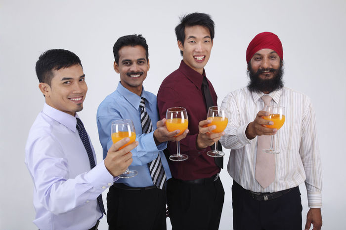 group of people holding glass of orange juice Business Celebration Happiness Indian Teamwork Business Person Chinese Formal Dress  Friendship Group Of People Harmony Malay Malaysian Man Made Object Mixed Race Multi Racial Orange Juice In Glass Portrait Punjabi Studio Shot Togetherness Toothy Smile Turban United Waist Up