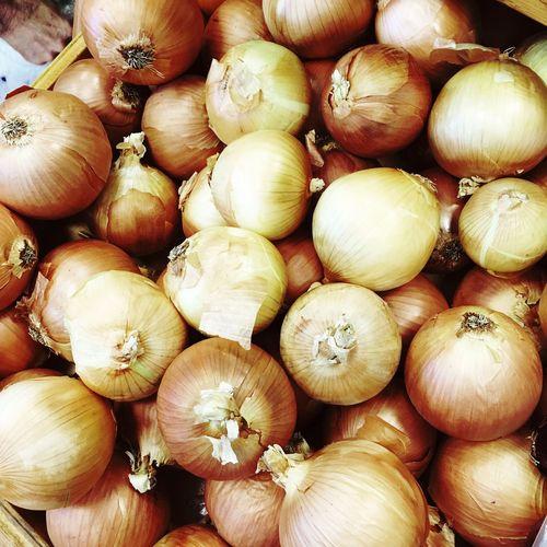 Full Frame Shot Of Onions In Market