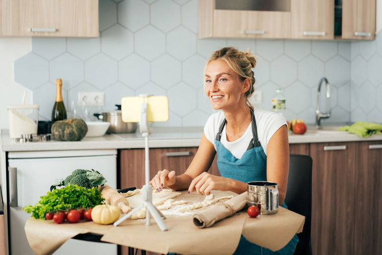 Portrait of woman preparing food at home
