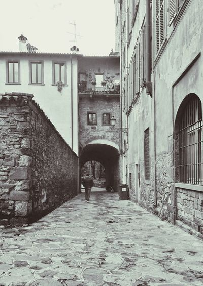 Alley with buildings in background