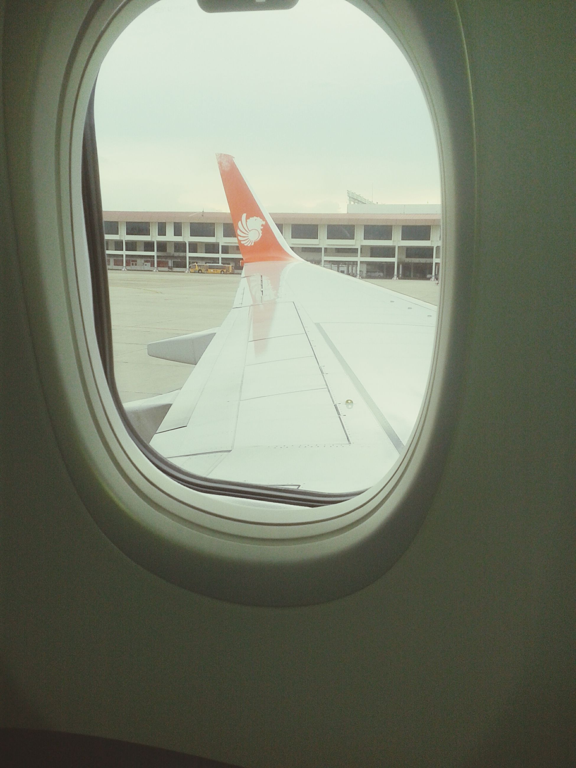 transportation, window, mode of transport, airplane, glass - material, transparent, air vehicle, indoors, vehicle interior, sky, built structure, architecture, travel, part of, cropped, day, journey, clear sky, geometric shape, reflection