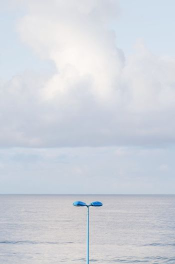 Minimalism Minimal Cloud Sky Sea Lamp Sea Water Sky Cloud - Sky Horizon Horizon Over Water Beauty In Nature Outdoors Nature Tranquility Beach Scenics - Nature Tranquil Scene