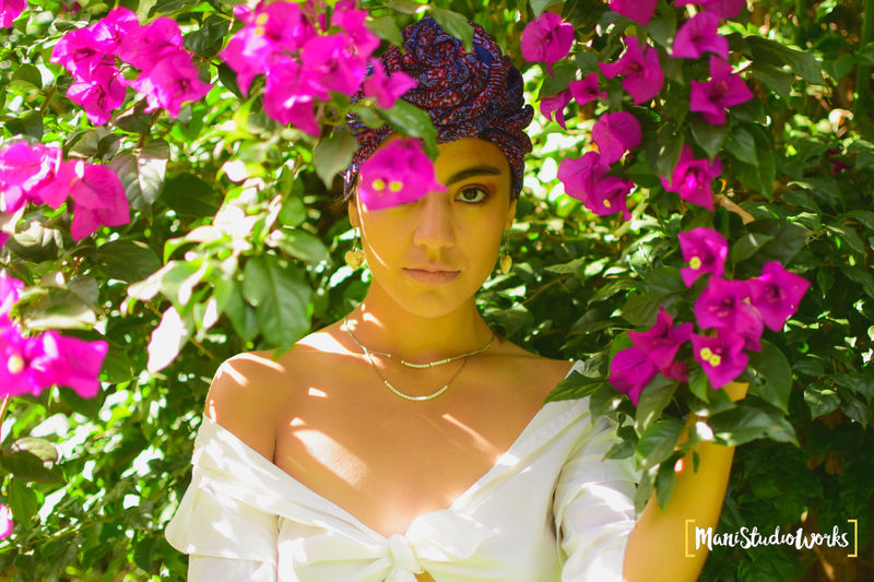 model shoots Fashion Beautiful Woman Beauty Beauty In Nature Flower Flower Head Flowering Plant Front View Green Color Leisure Activity Lifestyles Looking At Camera Nature One Person Outdoors Pink Color Plant Plant Part Portrait Purple Real People Women Young Adult Young Women