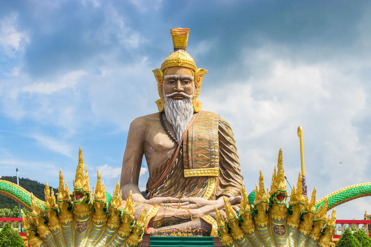Representation Sculpture Statue Sky Human Representation Art And Craft Architecture Belief Male Likeness Spirituality Religion Cloud - Sky Built Structure Gold Colored Creativity Nature Place Of Worship Low Angle View No People Outdoors Idol Ornate