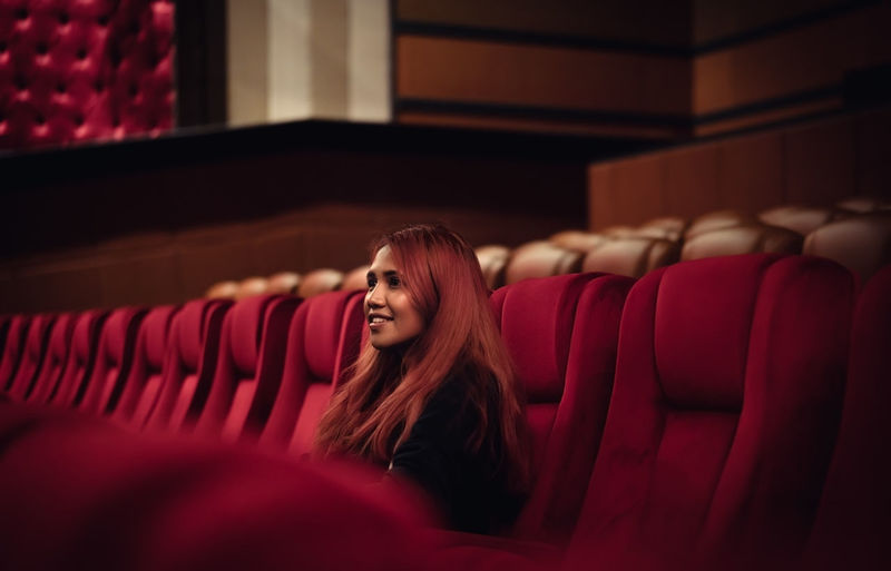 Smiling woman sitting in movie theater