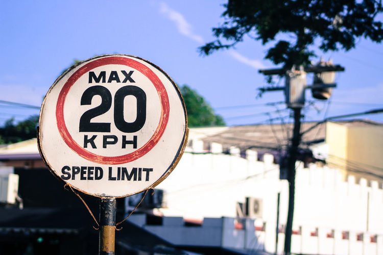 Speed limit sign against building