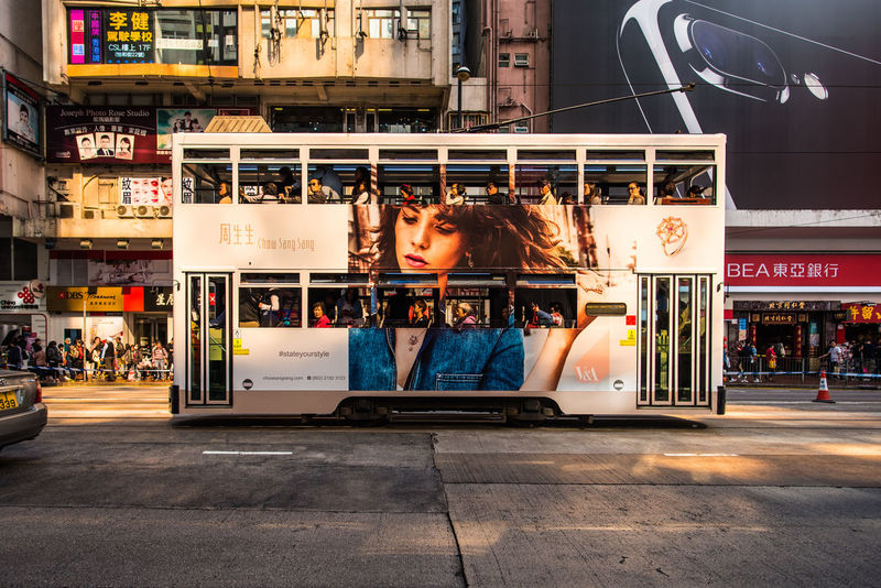 """CAUSEWAY BAY, HONG KONG - DECEMBER 10, 2016: Hong Kong Tramways is a public transport in metropolis. Known as """"Hong Kong Ding Ding"""" with classic and unique style of double-deck tram. ASIA City Ding Ding Hong Kong HongKong Passenger Public Transportation Road Traffic Tranquility Transport Transportation Travel Double Decker Bus Street Tourism Tramway Urban Vehicle"""