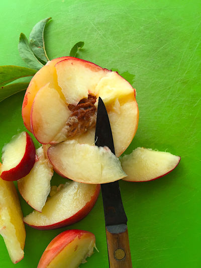 Fresh peach with paring knife and copy space Close-up Copy Space Cutting Board Food Preparation Fresh Fruit Green Color Leaves Natural Light Nature Overhead Paring Knife Peach Phone Camera Raw Food Red Ripe Seasonal Sliced Fruit Summer Sweet Textures Yellow