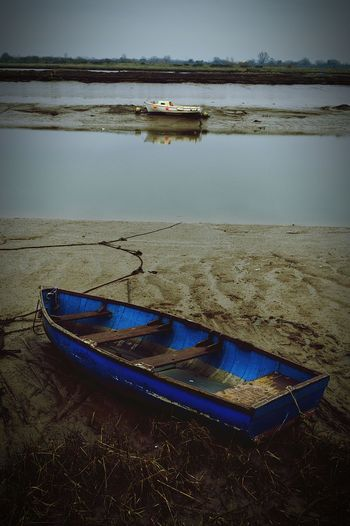 Looks like two pictures, but is just one shot! Where I Grew Up Boat Boats Blue Boat Estuary Mud Muddy Squelchy Mud Winter Time United Kingdom Nikon D3200