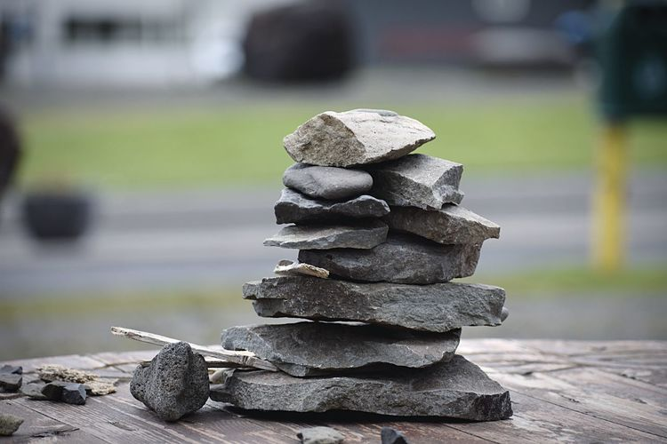 Stacked flat rocks EyeEm Selects Stack Focus On Foreground Balance Close-up Day No People Still Life Solid Stone - Object Rock Large Group Of Objects Black Color Rock - Object Pebble Group Of Objects Textured  Outdoors