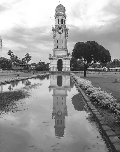 EyeEm Selects Clock tower ij Hazarduari, Murshidabad, West Bengal, India Reflection Cloud - Sky Architecture Water Travel Destinations No People Tree Outdoors Day Building Exterior The Great Outdoors - 2017 EyeEm Awards Built Structure History Tourism Architectural Column India Photography India, Murshidabad West Bengal