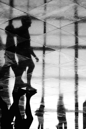 - Walking Reflection EyeEm Best Shots - Black + White EyeEm Gallery Streetphotography Travcimages Nycphotographer EyeEm Best Shots FUJIFILM X-T2 Real People Flooring Shadow Reflection Low Section Lifestyles Water Unrecognizable Person Walking Tiled Floor People The Street Photographer - 2018 EyeEm Awards