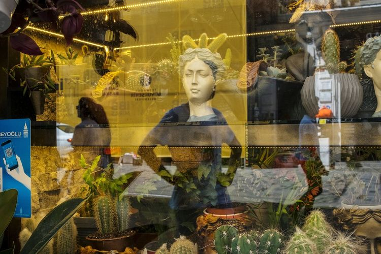 Digital composite image of statues in store