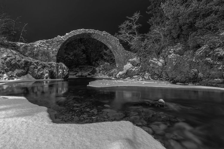 The old Packhorse bridge, Carrbridge. Ice River Dulnain Bridge Historic Carrbridge