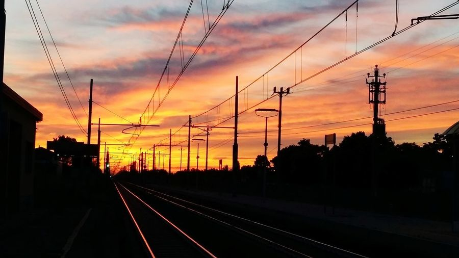 Tramonto Sulla Ferrovia Electricity Pylon Tree Sunset Electricity  Cable Silhouette Railroad Track Rail Transportation Business Finance And Industry Steel Railway Signal Passenger Train Public Transportation Railroad Crossing Train Railway Station Railway Station Platform