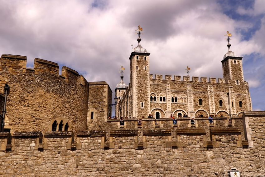 The battlements of the historic Tower of London UK, founded in 1066 the White Tower was built by William the Conqueror in 1078. Castle Historical Building Tourist Attraction  Tower Of London Travel Photography Architecture Battlement Building Exterior Built Structure Cloud - Sky Day Defence Fortification History Looking Up No People Outdoors Sky Tourist Destination Travel Destinations