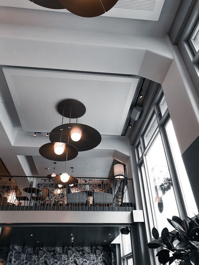 Low angle view of illuminated pendant lights in restaurant