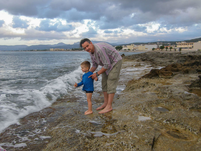 Father's and son's day Kreta Second Acts The Week On EyeEm Travel Travel Photography Traveling Vacation Time Vacations Beach Casual Clothing Childhood Cloud - Sky Family With One Child Father And Son Full Length Greece Kissamos Leisure Activity Lifestyles Nature Outdoors Real People Sea Togetherness Travel Destinations