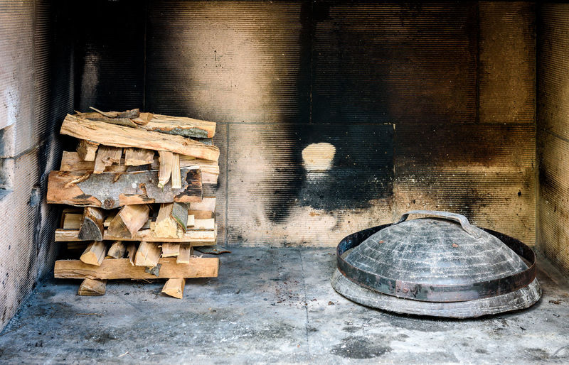 Preparing and Cooking of octopus and chicken in traditional Balkan Croatian Greek Mediterranean meal Peka in metal pots called sac sach or sache or a lid. Traditional roast of octopus and chicken with potatoes onions garlic tomato and spices. Fireplace with open fire and burning coals. Croatia Homemade Mediterranean Sea Mediterranean Food Metal Pot Chick Coals Fire Fireplace Food Grill Lid Octopus Octopuss Peka Pod Peko Potatoes Preparing Roast Sac Sache Speciality Traditional Vegetables