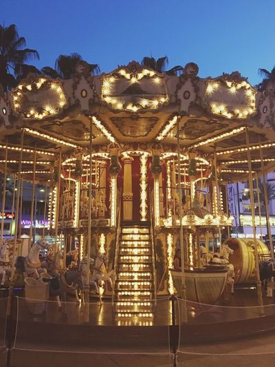 Illuminated Amusement Park Ride Lighting Equipment Carousel Arts Culture And Entertainment Amusement Park Built Structure Architecture No People Night Decoration Light Glowing Outdoors Representation Sky Low Angle View Art And Craft Hanging Ornate