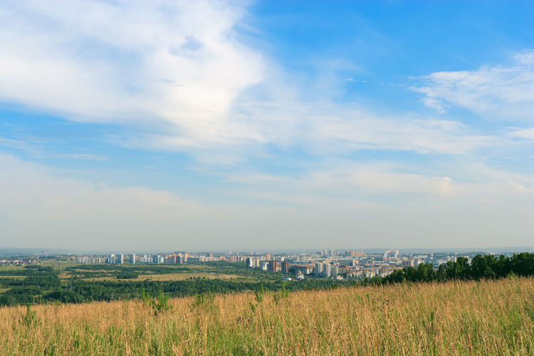 City Cityscape Cloud - Sky Day Environment Field Grass Land Landscape No People Outdoors Siberia Sky Summer Tranquil Scene Tranquility