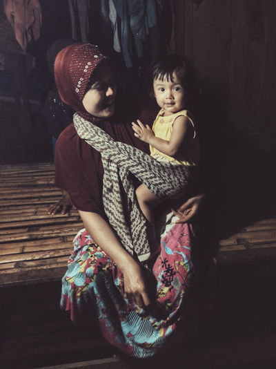 RePicture Motherhood Portrait Photography Portraits Life In Motion Lowlight Women Of EyeEm Mother & Daughter Cultures Aceh Showcase: February EyeEm Indonesia Eyeem Aceh Women Who Inspire You Learn & Shoot: Single Light Source Affection Mother's Day Mothersday