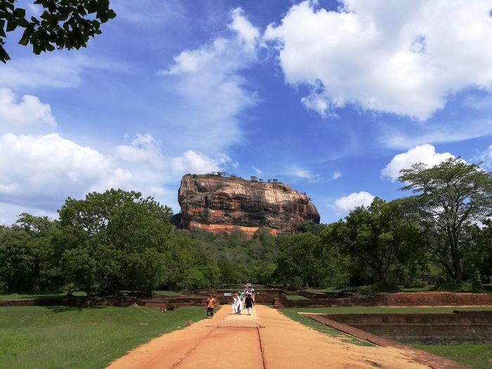 Lion Rock Beauty In Nature Cloud - Sky Day History Land Leisure Activity Lifestyles Nature Non-urban Scene Outdoors Plant Real People Rock Rock Formation Scenics - Nature Sigiriya Sky Tranquility Travel Tree Walking